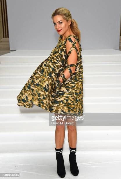 Olivia Cox attends the Paul Costelloe catwalk show during London Fashion Week at The Waldorf London on September 18 2017 in London England