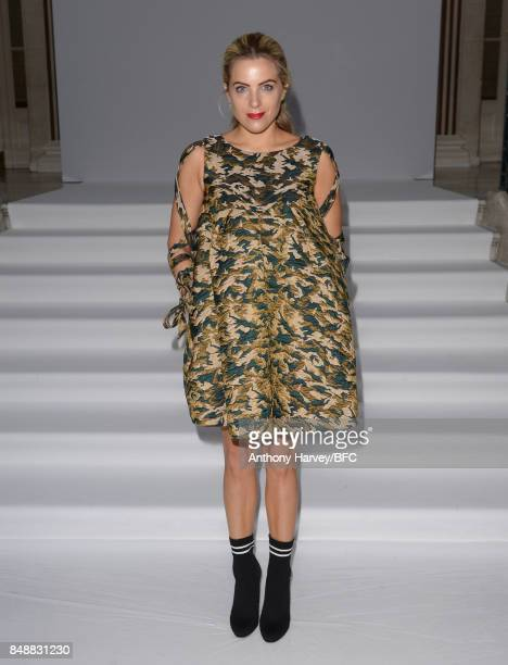 Olivia Cox attends the Paul Costelloe presentation during London Fashion Week September 2017 on September 18 2017 in London England