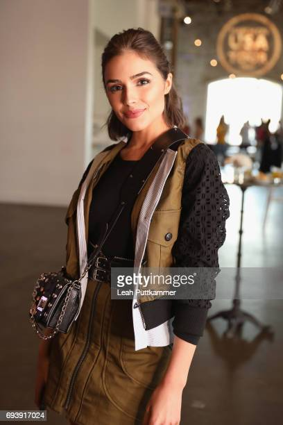 Olivia Culpo attends DSW ELLE Happy Hour event celebrating DSW's #MarchOn USA Tour at Acme Feed Seed on June 8 2017 in Nashville Tennessee