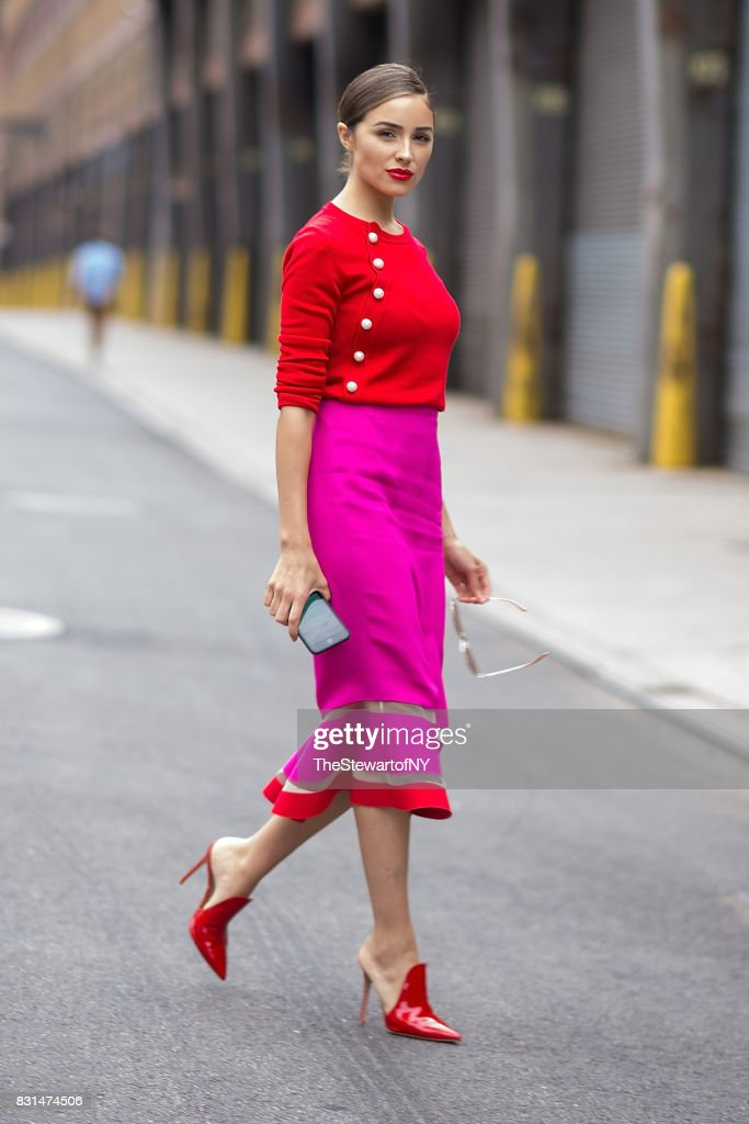 Olivia Culpo is seen wearing an Altuzarra sweater, Emanuel Ungaro skirt, Gianvito Rossi shoes and Linda Farrow sunglasses in SoHo on August 14, 2017 in New York City.