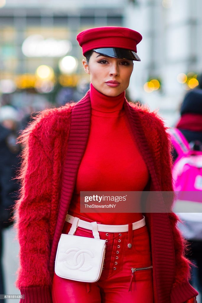 Olivia Culpo is seen wearing Max Mara with Jimmy Choo shoes and a Chanel belt bag in Midtown on November 23, 2017 in New York City.