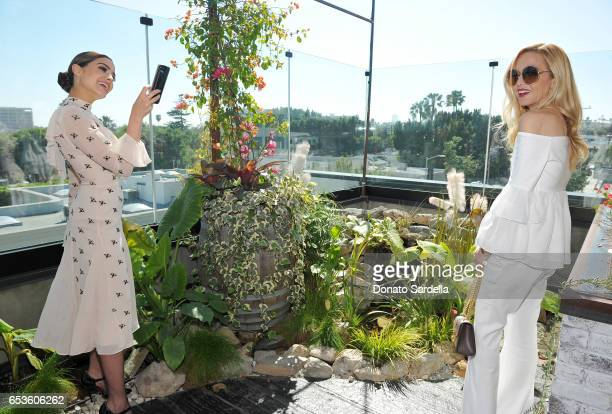 Olivia Culpo takes a photo of host Rachel Zoe at UGG SS17 campaign luncheon hosted by Rosie HuntingtonWhiteley and Rachel Zoe at Catch LA on March 15...