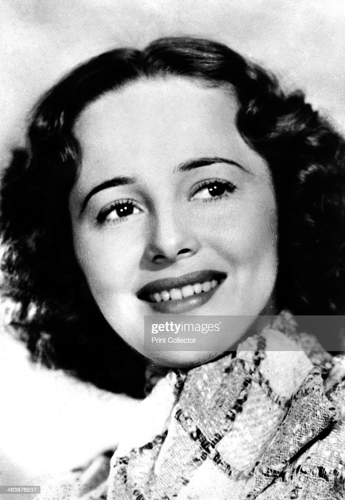 Olivia de Havilland (b.1916), American actress, c1930s-c1940s. De Havilland made her stage debut in 1935 as Hermia in A Midsummer Night's Dream; the following year she made her film debut in the same role. Soon afterwards, she was signed to a seven-year contract by Warner Bros., where she starred as a sweetly beautiful romantic heroine, often opposite Errol Flynn, in films such as Captain Blood (1935), The Adventures of Robin Hood (1938) and The Private Lives of Elizabeth and Essex (1939). She won two Best Actress Academy Awards - for To Each His Own (1946) and The Heiress (1949) - and received a further three nominations - one of which was for Gone With the Wind (1939). Her sister is the actress Joan Fontaine.