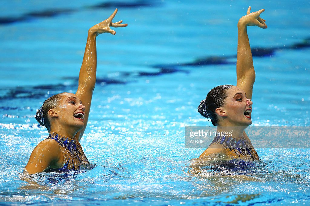 Olivia Federici and <a gi-track='captionPersonalityLinkClicked' href=/galleries/search?phrase=Jenna+Randall&family=editorial&specificpeople=801148 ng-click='$event.stopPropagation()'>Jenna Randall</a> of Great Britain compete in the Women's Duets Synchronised Swimming Free Routine Preliminary on Day 10 of the London 2012 Olympic Games at the Aquatics Centre on August 6, 2012 in London, England.