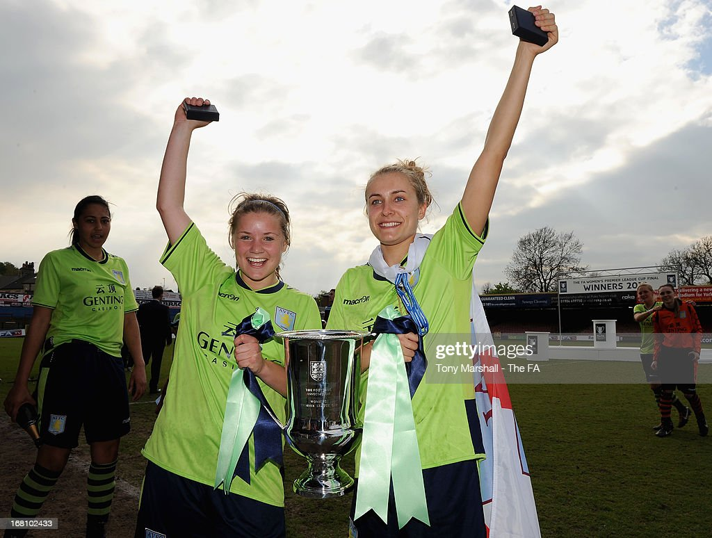 Olivia Fergusson and Emma Follis (R) of Aston Villa Ladies celebrate with the trophy after winning the FA Women's Premier League Cup Final between Aston Villa Ladies and Leeds United Ladies at Bootham Crescent Stadium on May 5, 2013 in York, England.