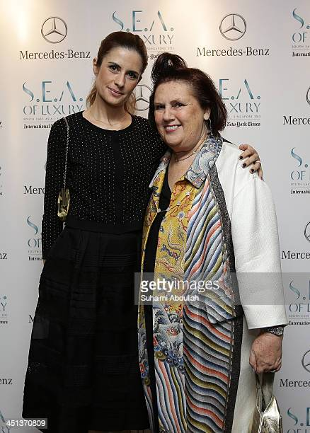 Olivia Firth and International New York Times International Fashion Editor Suzy Menkes arrive at the Flower Dome on November 20 2013 in Singapore The...