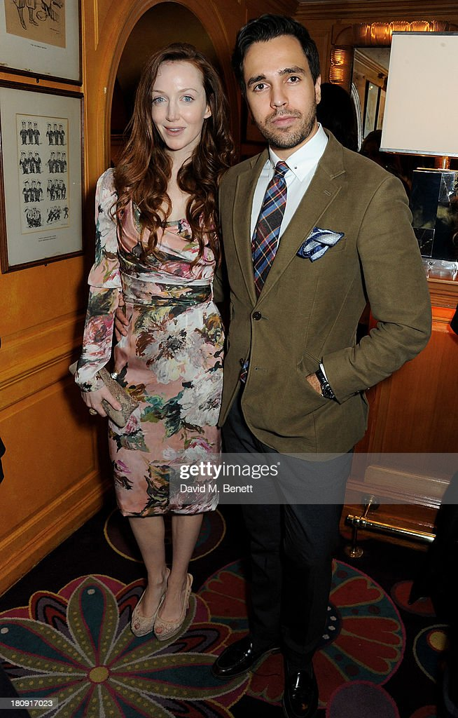 Olivia Grant (L) and Diego Bivero-Volpe attend the Harper's Bazaar London Fashion Week SS14 closing party at Annabel's on September 17, 2013 in London, England.
