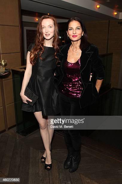 Olivia Grant and Jasmin Mills attend Tara Bernard Jade Jagger's Christmas Party at the Belgraves Hotel on December 9 2014 in London England