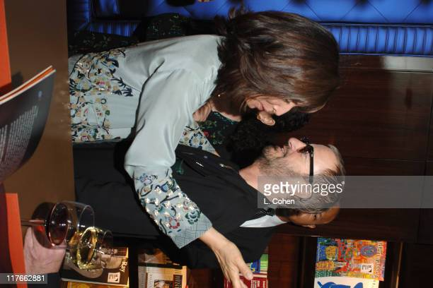 Olivia Harrison and Ringo Starr during Olivia Harrison Signs Her Book 'Concert for George' March 15 2005 at Taschen in Beverly Hills California...