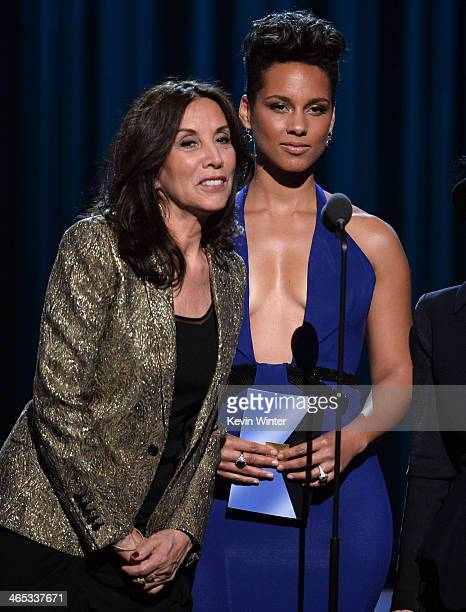 Olivia Harrison and singer Alicia Keys speak onstage during the 56th GRAMMY Awards at Staples Center on January 26 2014 in Los Angeles California