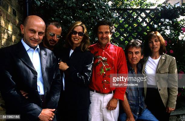 Olivia Harrison George Harrison Ringo Starr and Barbara Bach with Romanian Angel Appeal founder Angelo Moschino United Kingdom 2000
