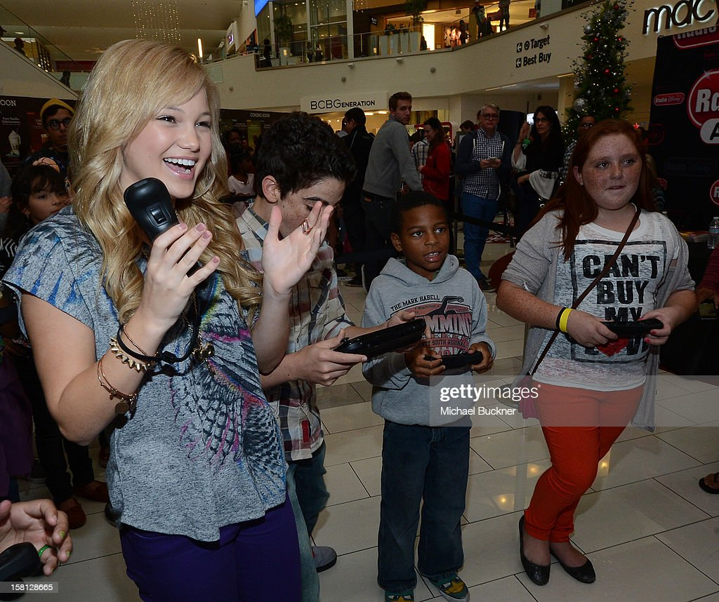 <a gi-track='captionPersonalityLinkClicked' href=/galleries/search?phrase=Olivia+Holt&family=editorial&specificpeople=7563645 ng-click='$event.stopPropagation()'>Olivia Holt</a> (L) and Cameron Boyce stars of Disney Channel's hit series 'Jessie' battle in the Wii U Showdown at Westfield Century City Mall in Los Angeles on December 9, 2012. Wii U is one of Nintendo's hottest items of the holiday season.