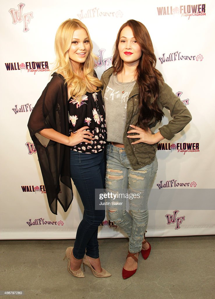 Olivia Holt and Kelli Berglund attend Fashion Night Out Event With Disney Starlet Olivia Holt on October 6 2014 in Los Angeles California