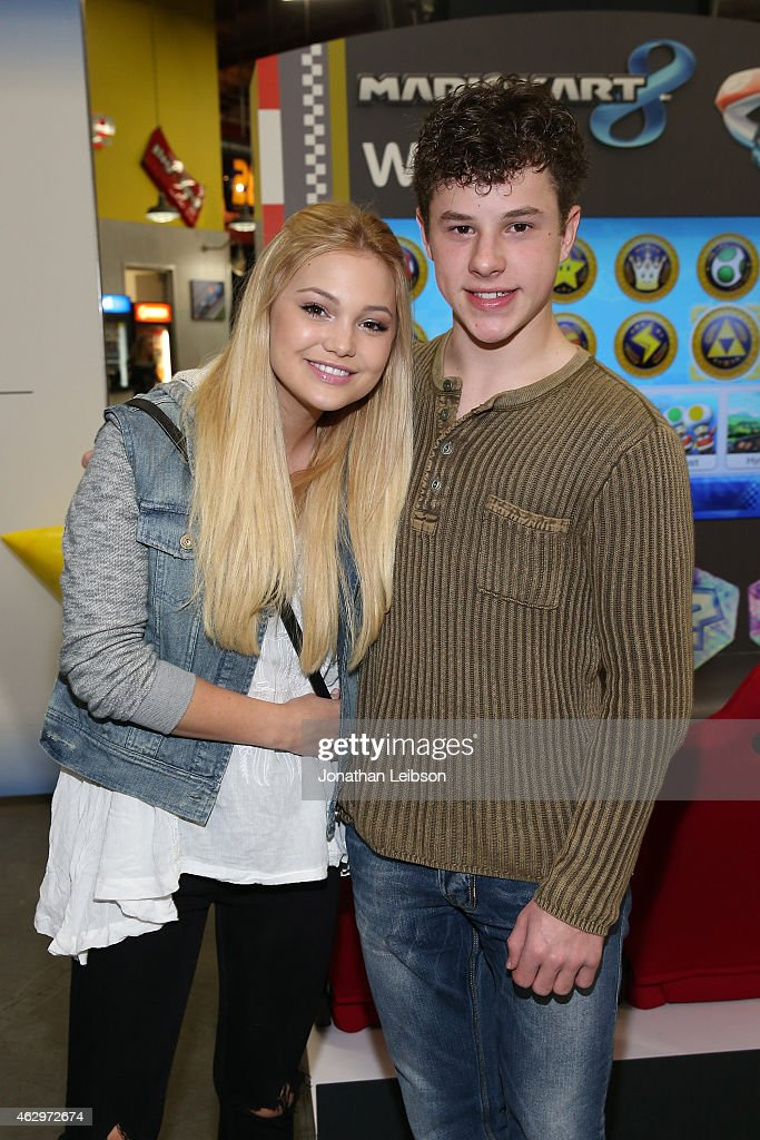 <a gi-track='captionPersonalityLinkClicked' href=/galleries/search?phrase=Olivia+Holt&family=editorial&specificpeople=7563645 ng-click='$event.stopPropagation()'>Olivia Holt</a> and <a gi-track='captionPersonalityLinkClicked' href=/galleries/search?phrase=Nolan+Gould&family=editorial&specificpeople=5691358 ng-click='$event.stopPropagation()'>Nolan Gould</a> attend the Dylan Riley Snyder Races Into His 18th Year With Nintendo at K1 Speed on February 7, 2015 in Gardena, California.