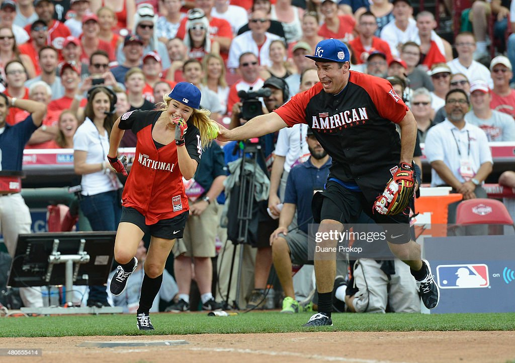 Olivia Holt (L) tries to out run being tagged by Rob Riggle during the 2015 MLB All-Star Legends And Celebrity Softball Game at Great American Ball Park on July 12, 2015 in Cincinnati, Ohio.