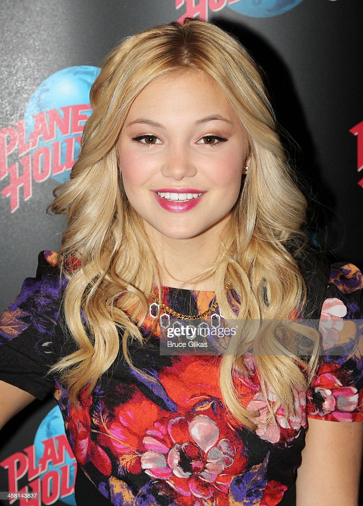 Olivia Holt visits Planet Hollywood Times Square on December 19 2013 in New York City
