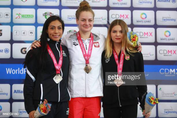 Olivia Jabslonka of Poland Gold Medal Cristina Zapata of Mexico Silver Medal and Pap Bianka Bronze Medal of Hungry pose after women's 400 m Freestyle...