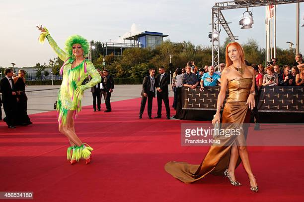 Olivia Jones andYasmina Filali attend the red carpet of the Deutscher Fernsehpreis 2014 on October 02 2014 in Cologne Germany