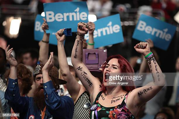 Olivia LoveHatlestad of Grayslake IL cheers during the second day of the Democratic National Convention at the Wells Fargo Center July 26 2016 in...