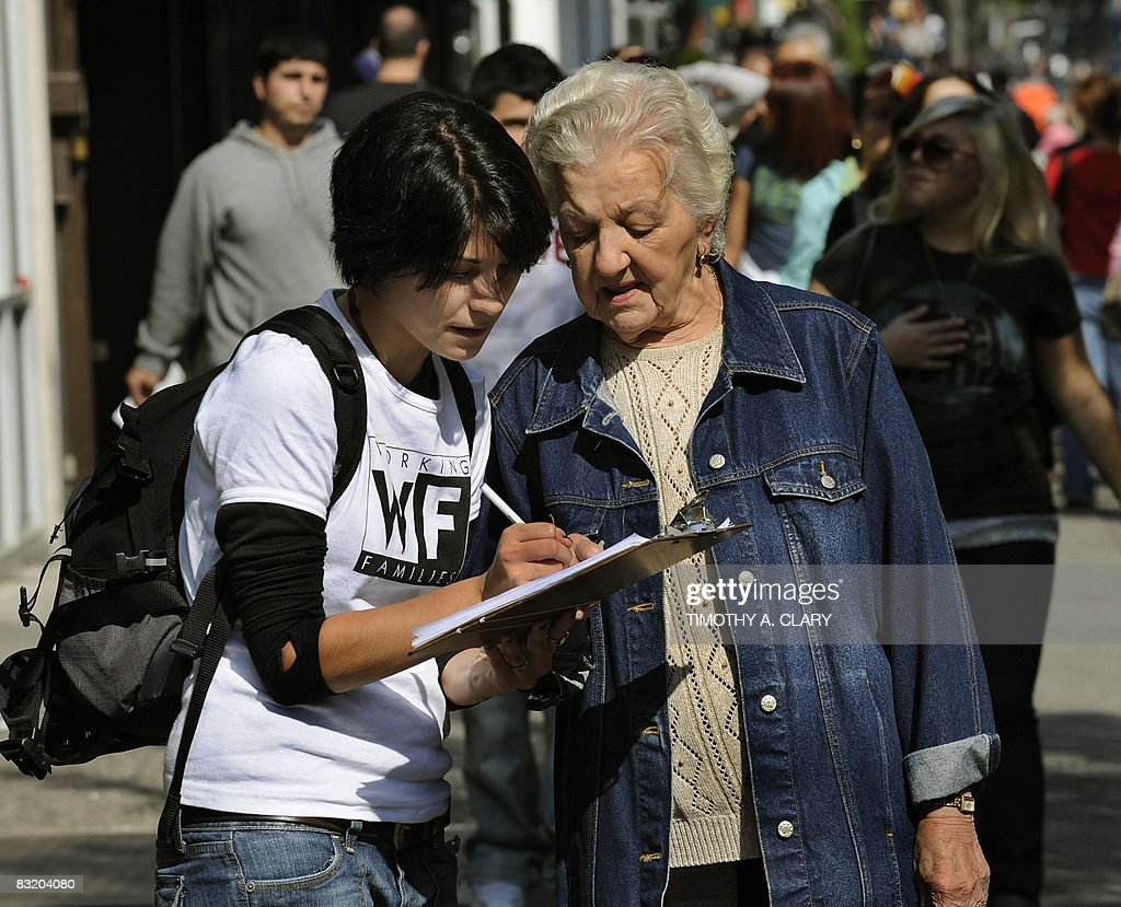 Olivia Mata with the Working Families Party gets a petition signed by Josephine Ferreiro in Astoria Queens October 9 2008 as part of a campaign to...