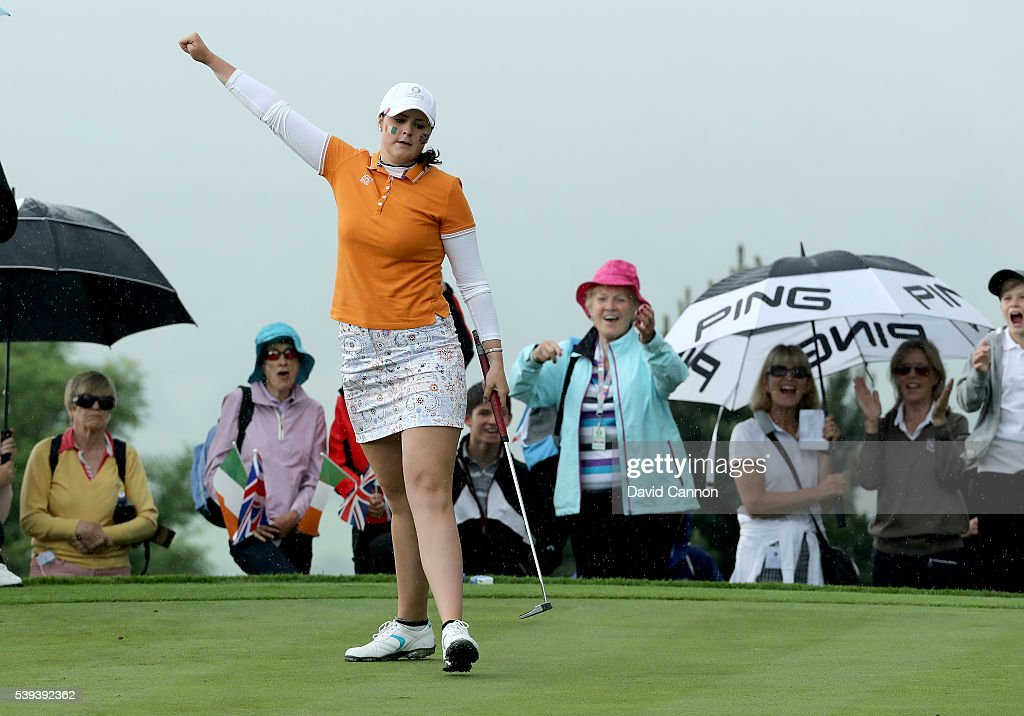 Olivia Mehaffey of Northern Ireland and the Great Britain and Ireland Team holes a birdie putt on the 9th green in her match with Bronte Law against...