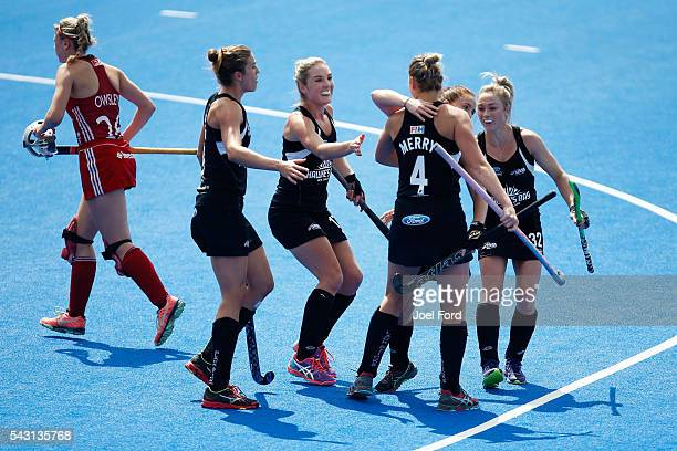 Olivia Merry of New Zealand is congratulated by teammates after scoring during the FIH Women's Hockey Champions Trophy 2016 match between New Zealand...