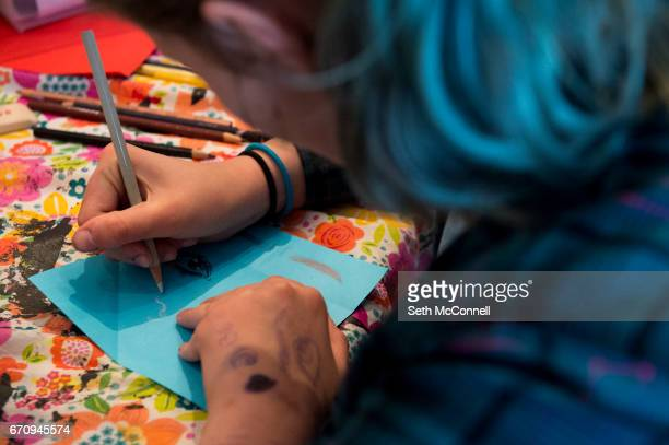 Olivia Mielke works on decorating her paper box with the theme of Mind Body and Soul during Lil Ladies Teen Art Studio at Violet Hive Art Therapy on...