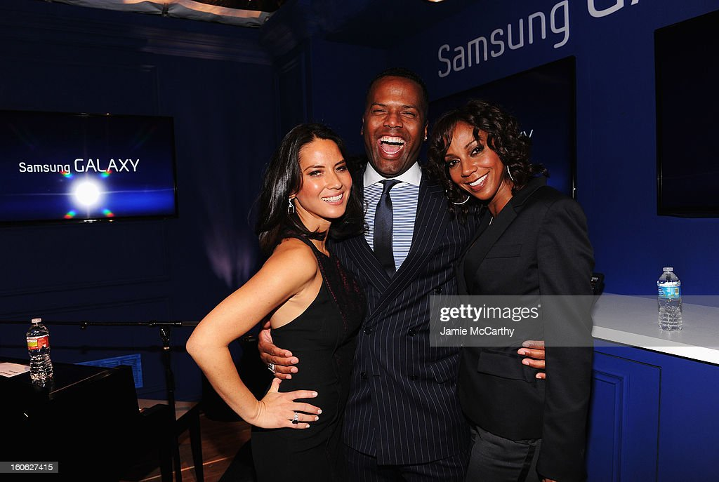"Olivia Munn, AJ Calloway and Holly Robinson Peete at the Samsung Galaxy ""Shangri-La"" Party on February 2, 2013 in New Orleans, Louisiana."