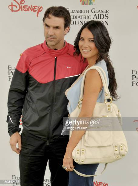 Olivia Munn and Paul Schneider arrive at the 22nd Annual A Time for Heroes Celebrity Carnival at the Wadsworth Theater on June 12 2011 in West Los...