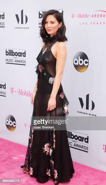 Olivia Munn arrives at the 2017 Billboard Music Awards presented by Virginia Black at TMobile Arena on May 21 2017 in Las Vegas Nevada
