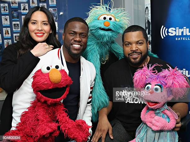 Olivia Munn Elmo Kevin Hart Rosita Ice Cube and Abby Cadabby pose for a photo before taking part in SiriusXM 'Town Hall' With Kevin Hart Ice Cube And...