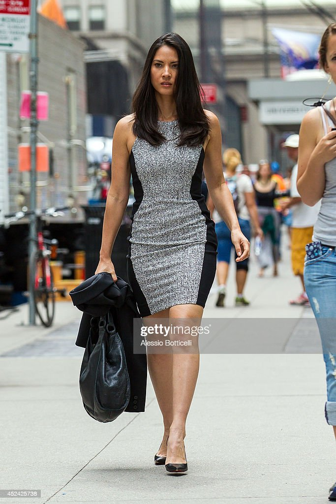 <a gi-track='captionPersonalityLinkClicked' href=/galleries/search?phrase=Olivia+Munn&family=editorial&specificpeople=598969 ng-click='$event.stopPropagation()'>Olivia Munn</a> is seen on location in Times Square for 'The Newsroom' on July 19, 2014 in New York City.