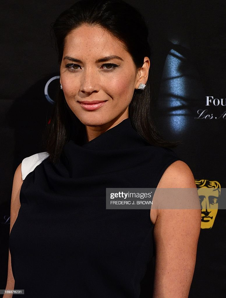 Olivia Munn poses on arrival for the British Academy of Film and Television Arts (BAFTA) Los Angeles Awards Season Tea Party on January 12, 2013 in Beverly Hills, California. AFP PHOTO / Frederic J. BROWN