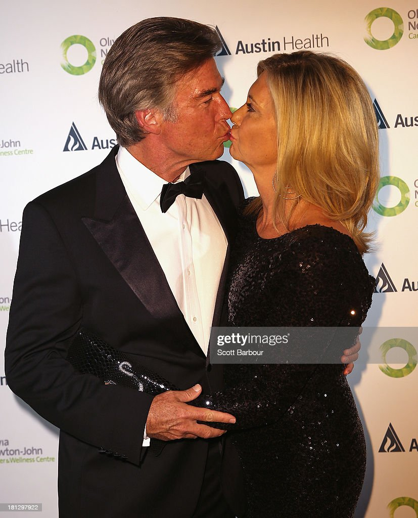 Olivia Newton-John and her husband John Easterling kiss as they arrive at the inaugural ONJ Gala to raise funds for the Olivia Newton-John Cancer & Wellness Centre at the Regent Plaza Ballroom on September 20, 2013 in Melbourne, Australia.