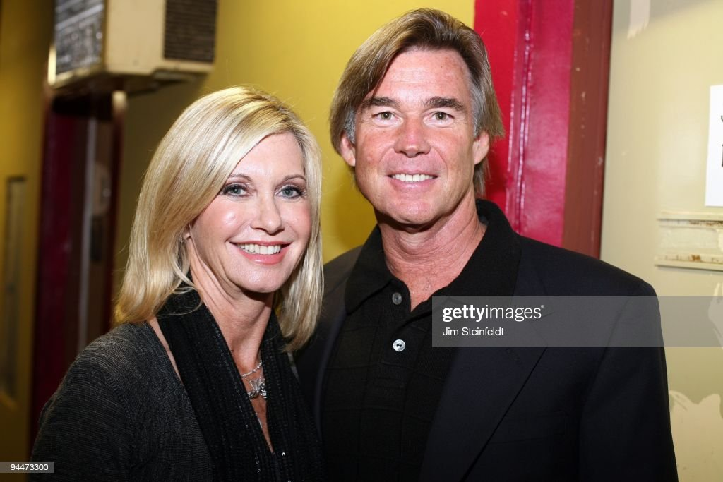Olivia Newton-John and husband John Easterling pose for a portrait at the Cancer Schmancer Rock Comedy benefit for 'I HEART INC' at the Million Dollar Theater in Los Angeles, California on December 13, 2009.
