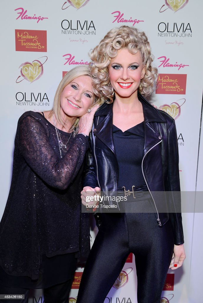 Olivia Newton-John poses side-by-side to reveal brand new Madame Tussauds Hollywood wax figure at the Flamingo Las Vegas on August 9, 2014 in Las Vegas, Nevada.