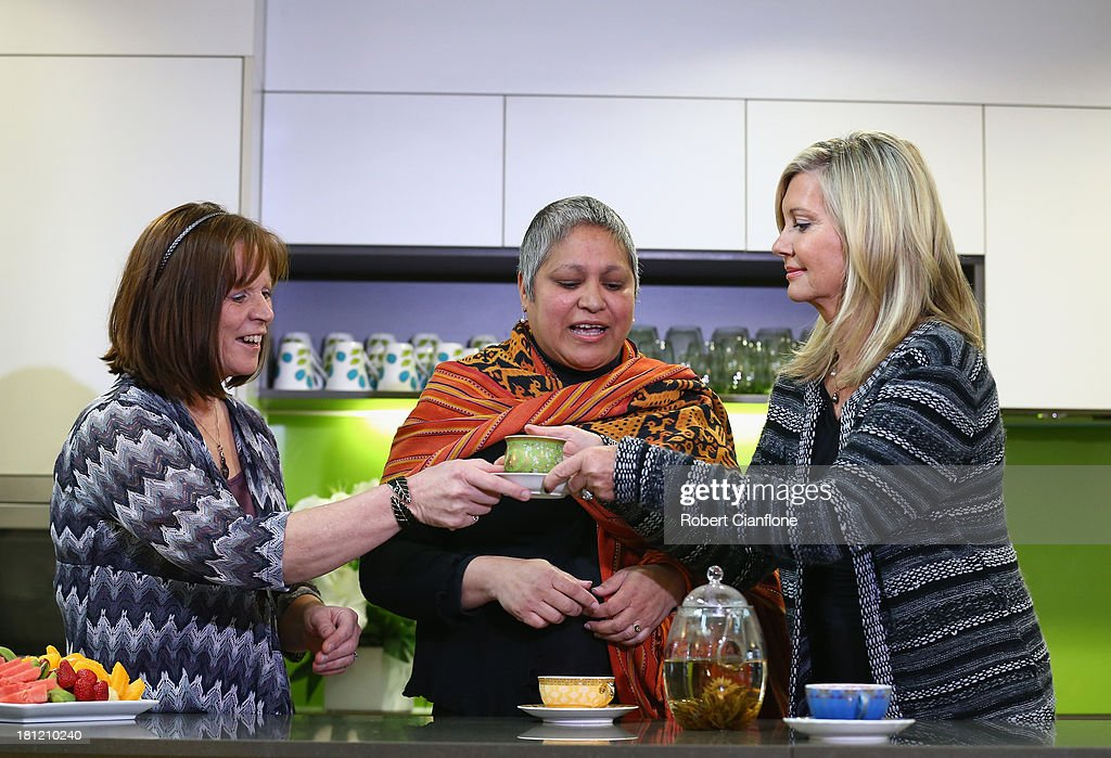 Olivia Newton-John speaks to carer Shirley Archer and patient Ana Noronha prior to the formal opening of the Olivia Newton John Cancer & Wellness Centre at Austin Hospital on September 20, 2013 in Melbourne, Australia.