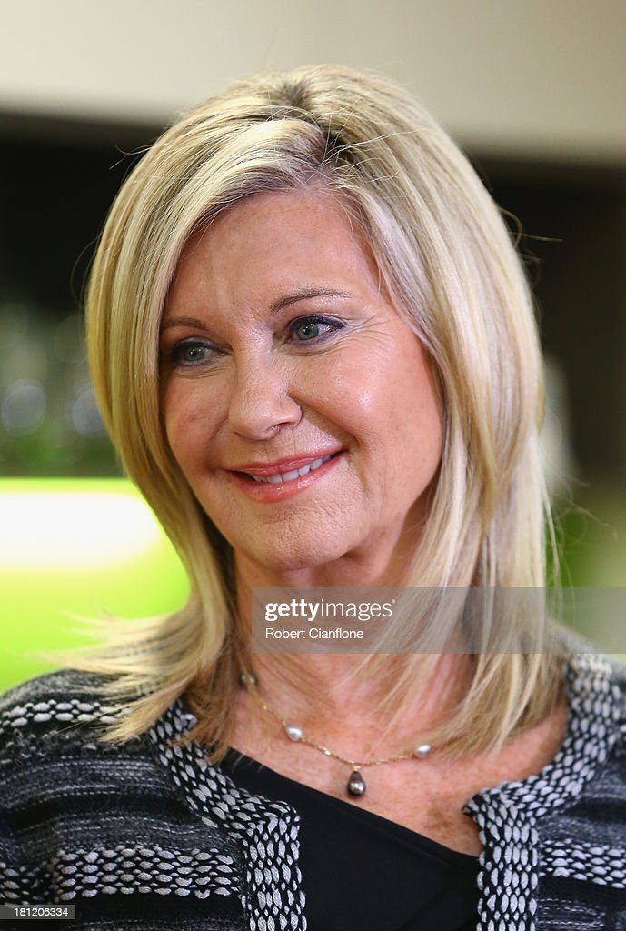 Olivia Newton-John speaks to the media prior to the formal opening of the <a gi-track='captionPersonalityLinkClicked' href=/galleries/search?phrase=Olivia+Newton+John&family=editorial&specificpeople=206842 ng-click='$event.stopPropagation()'>Olivia Newton John</a> Cancer & Wellness Centre at Austin Hospital on September 20, 2013 in Melbourne, Australia.
