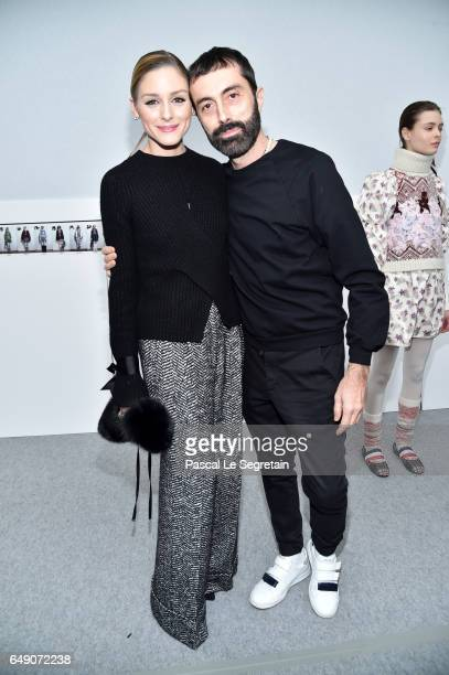 Olivia Palermo and Giambattista Valli attend the Moncler Gamme Rouge show as part of the Paris Fashion Week Womenswear Fall/Winter 2017/2018 on March...