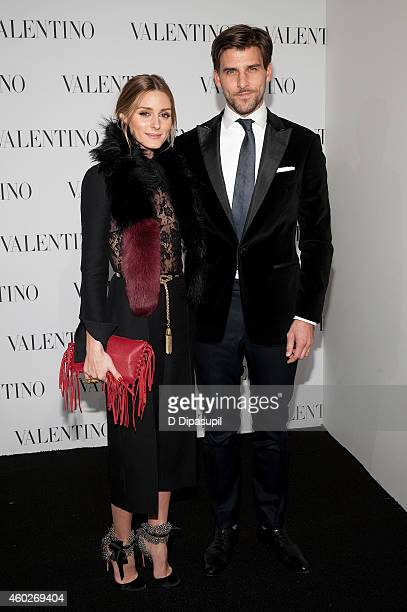 Olivia Palermo and husband Johannes Huebl attend the Valentino Sala Bianca 945 Event on December 10 2014 in New York City