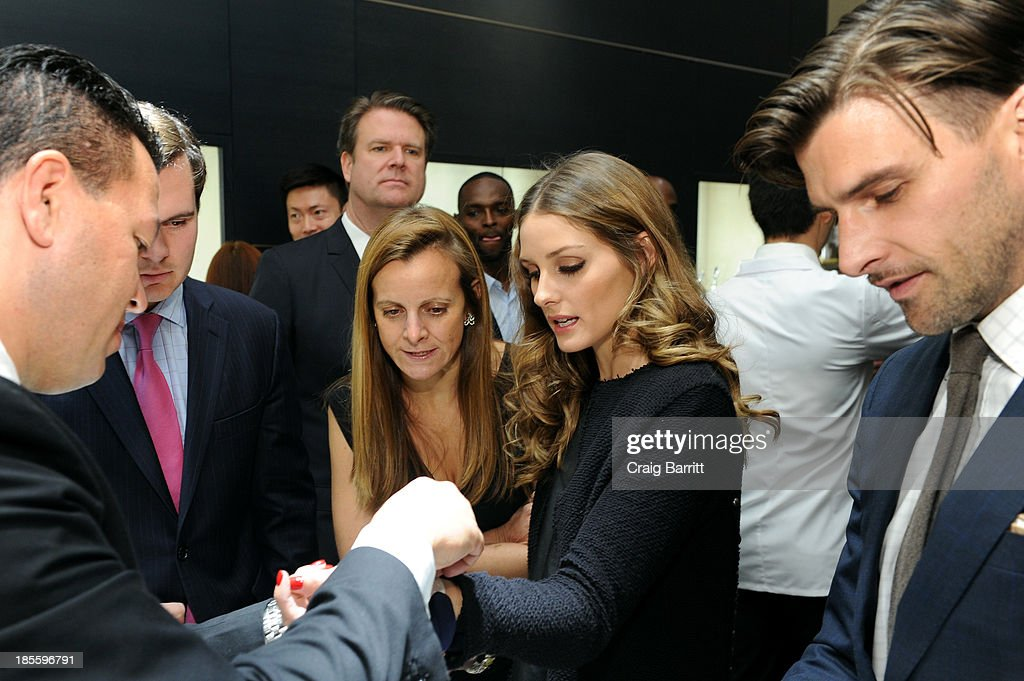 <a gi-track='captionPersonalityLinkClicked' href=/galleries/search?phrase=Olivia+Palermo&family=editorial&specificpeople=2639086 ng-click='$event.stopPropagation()'>Olivia Palermo</a>(C) and <a gi-track='captionPersonalityLinkClicked' href=/galleries/search?phrase=Johannes+Huebl&family=editorial&specificpeople=5696811 ng-click='$event.stopPropagation()'>Johannes Huebl</a> (R) attend Montblanc celebrates Madison Avenue Boutique Opening at Montblanc Boutique on Madison Avenue on October 22, 2013 in New York City.