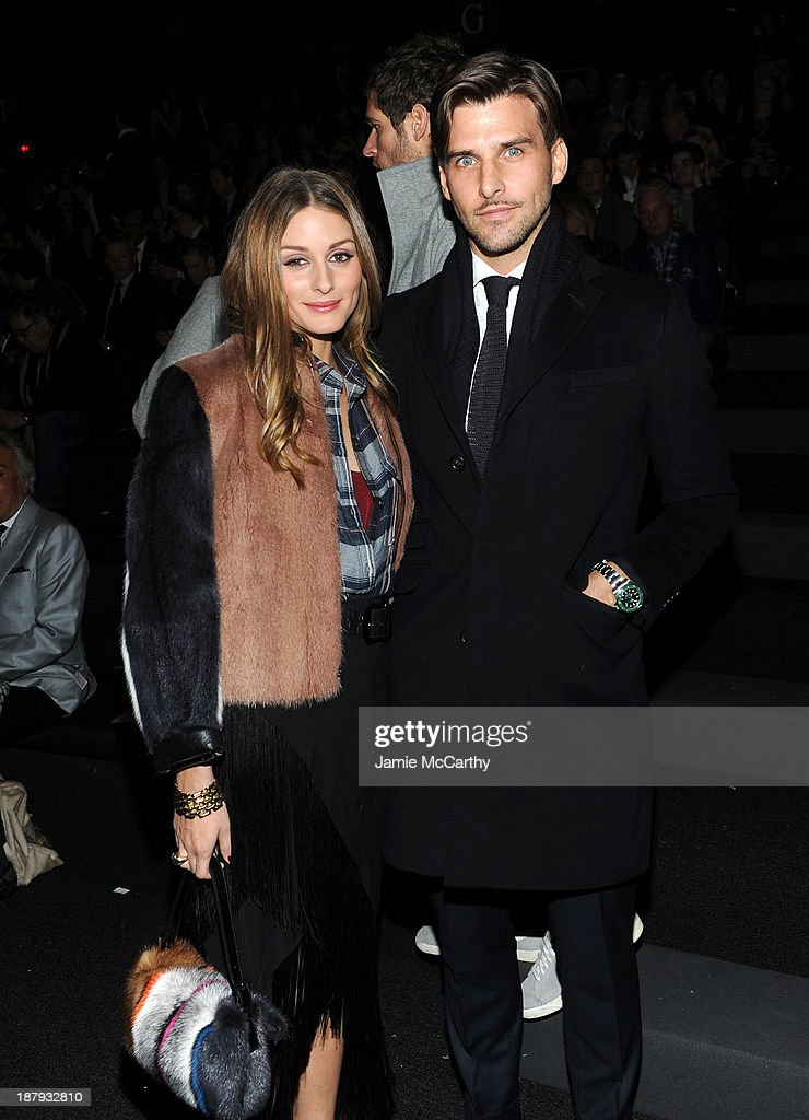 Olivia Palermo and Johannes Huebl attend the 2013 Victoria's Secret Fashion Show at Lexington Avenue Armory on November 13, 2013 in New York City.