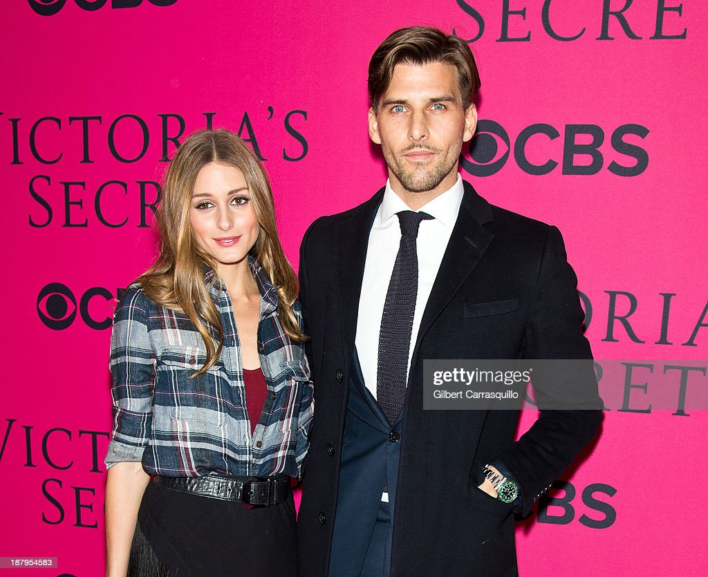 Olivia Palermo (L) and Johannes Huebl attend the 2013 Victoria's Secret Fashion Show at Lexington Avenue Armory on November 13, 2013 in New York City.