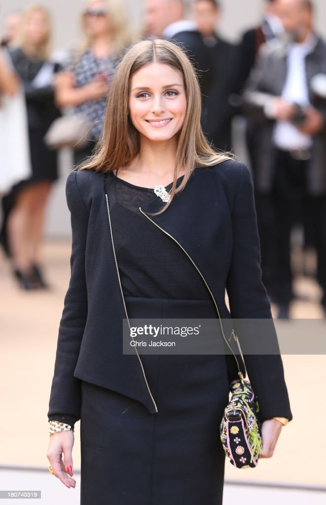 Olivia Palermo attends the Burberry Prorsum show at London Fashion Week SS14 at Kensington Gardens on September 16, 2013 in London, England.