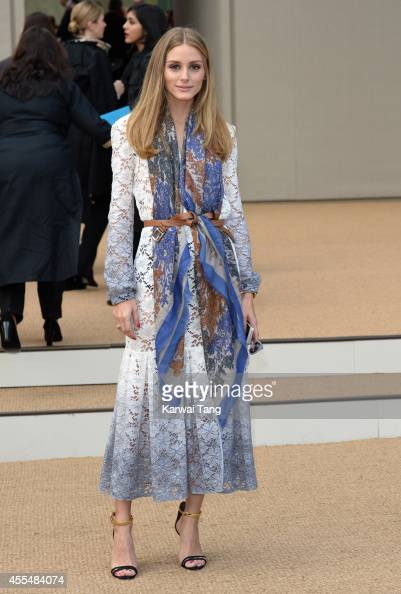 Olivia Palermo attends the Burberry Prorsum show during London Fashion Week Spring Summer 2015 at Kensington Gardens on September 15 2014 in London...