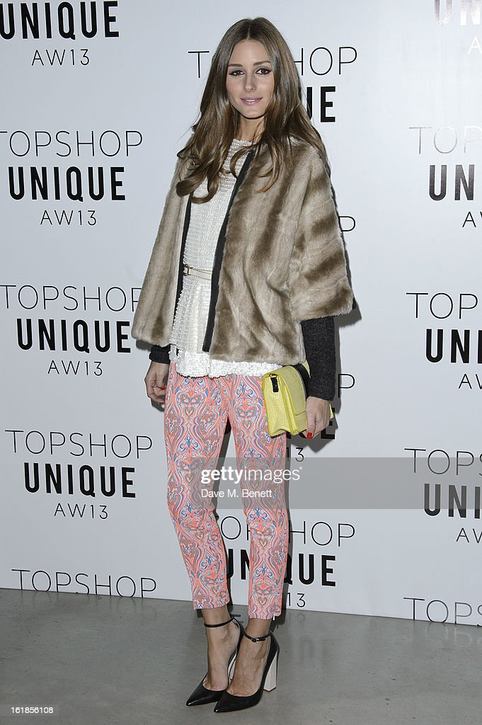 Olivia Palermo attends the Topshop Unique Autumn/ Winter 2013 catwalk show at the Topshop Show Space on February 17, 2013 in London, England.