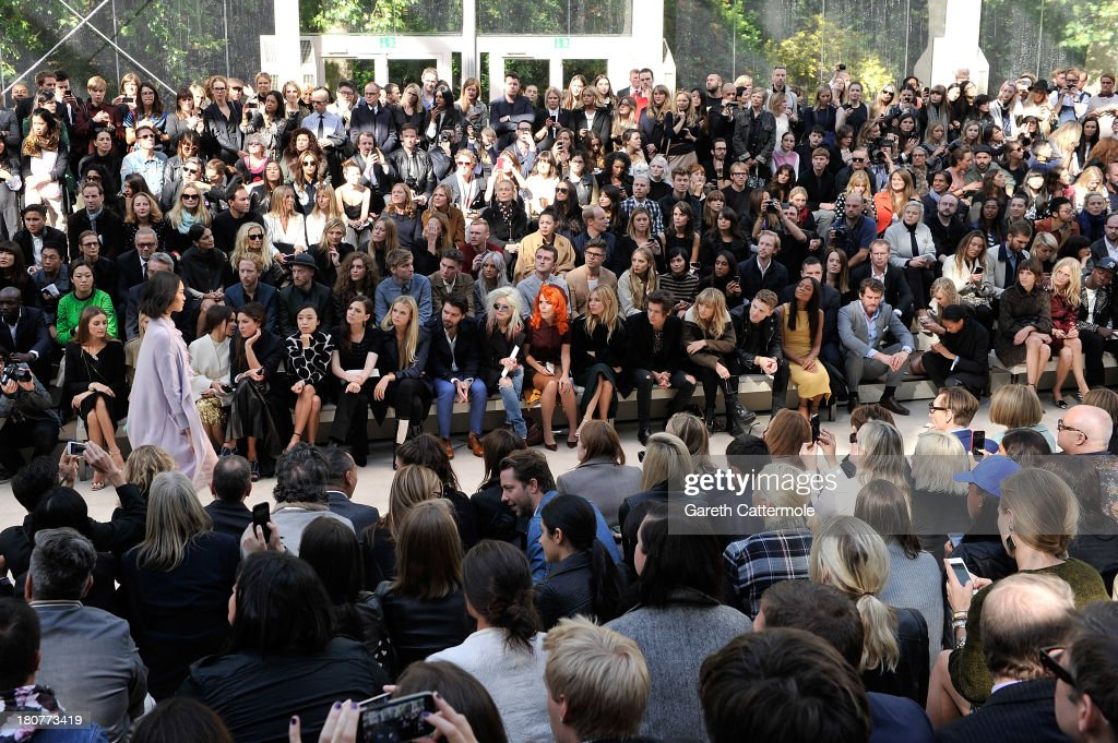 Olivia Palermo, Elena Perminova, Miraoslava Duma, Hayley Atwell; Jeon Do-Yeon, Gabriella Wilde, Simon Neil, Alison Mosshart, Paloma Faith, Sienna Miller Harry Styles, Suki Waterhouse, George Barnett, Naomie Harris, Alexa Chung, Poppy Delevingne and Jamal Edwards sit in the front row at Burberry Prorsum Womenswear Spring/Summer 2014 show during London Fashion Week at Kensington Gardens on September 16, 2013 in London, England.