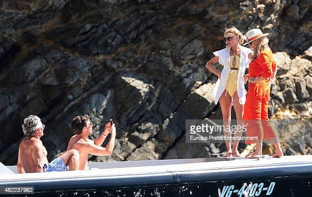Olivia Palermo her mother Lynn Hutchings and her husband Johannes Huebl are seen on July 28 2015 in Ibiza Spain