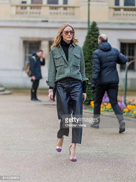 Olivia Palermo wearing a green jacket and black leather pants outside Giambattista Valli during the Paris Fashion Week Womenswear Fall/Winter...