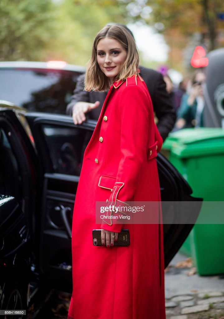 Olivia Palermo wearing a red coat seen outside Valentino during Paris Fashion Week Spring/Summer 2018 on October 1, 2017 in Paris, France.